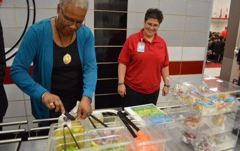 USDA Represenative Audrey Rowe selects toppings from the lunch line.