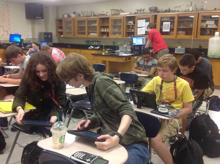Kate+Lahey+%2815%29%2C+Derek+Thomas+%2815%29+and+Jacob+Gordan+%2815%29+in+AP+Chemistry+using+their+iPads+to+do+work.+