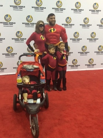 An adorable family cosplaying as The Incredibles.