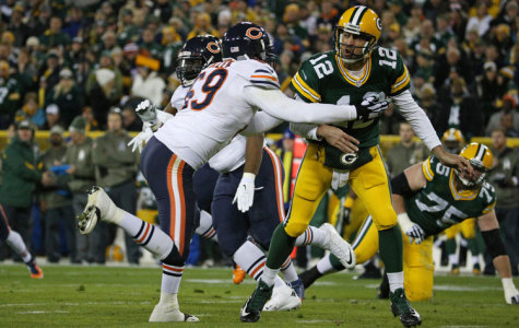 Green Bay Packers quarterback Aaron Rodgers (12) is tackled by Chicago Bears defensive end Jared Allen (69) after making a pass during the first quarter of an NFL football game between the Chicago Bears and the Green Bay Packers, Nov. 9, 2014 at Lambeau Field in Green Bay, Wis.