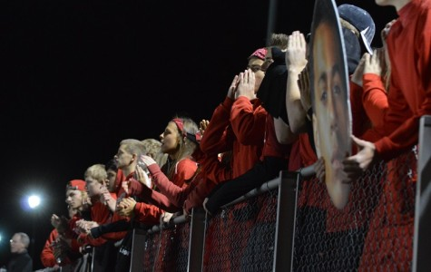 Seniors and varsity club members cheer on the varsity football team during the game against Fremd on Oct. 2.