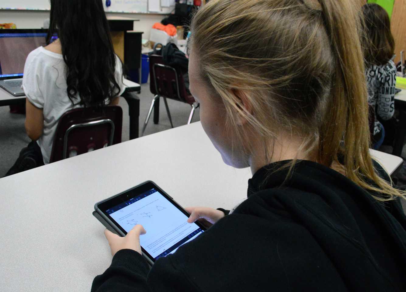 Freshman Cheyenne Voorhies works diligently on her iPad.