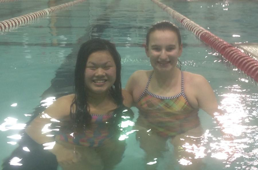 Molly Kleinfeldt (left) and Megan Obernesser (right) are all smiles after finishing a practice.