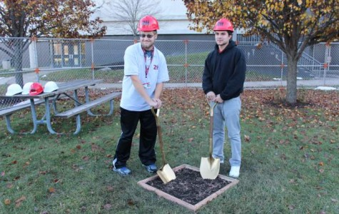 Adam Schlaiss and  Timothy Bonilla break ground for the new ATP building.