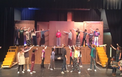 The musical cast rehearses the song