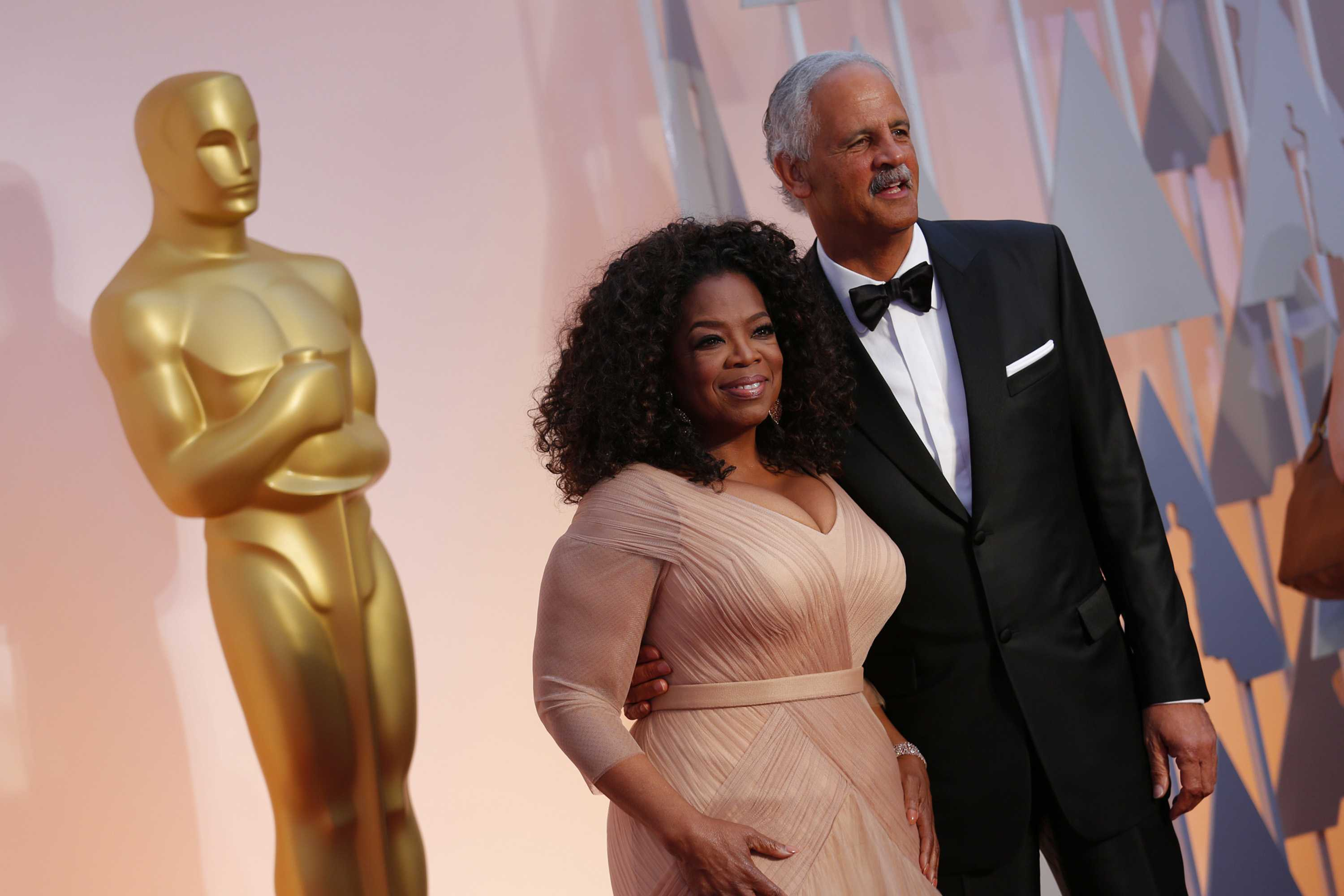 Oprah Winfrey and Stedman Graham arrive at the 87th Annual Academy Awards on Sunday, Feb. 22, 2015, at the Dolby Theatre in Hollywood.
