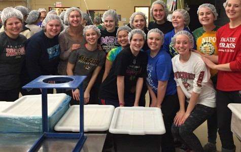 Service Club bonds over the joy of giving