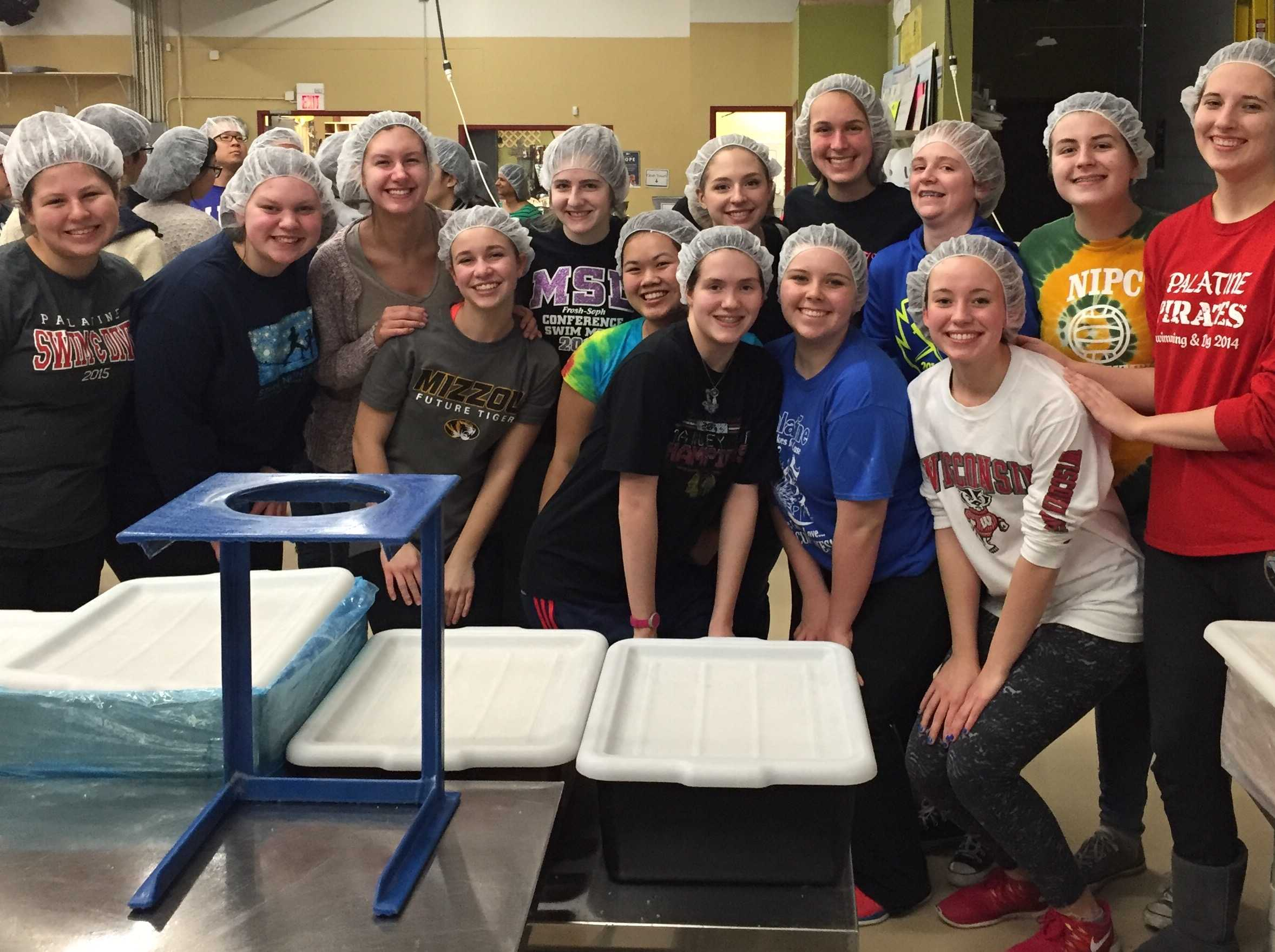 Service Club smiles after finishing their session at Feed My Starving Children, a nonprofit organization dedicated to ending worldwide hunger.
