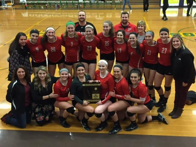 The+Palatine+varsity+volleyball+team+celebrates+their+regional+championship.