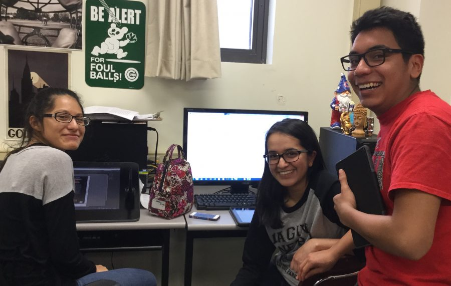 Freshman Adrian Salguero, junior Amber Singh, and senior Raquel Garcia gather together for a yearbook meeting.