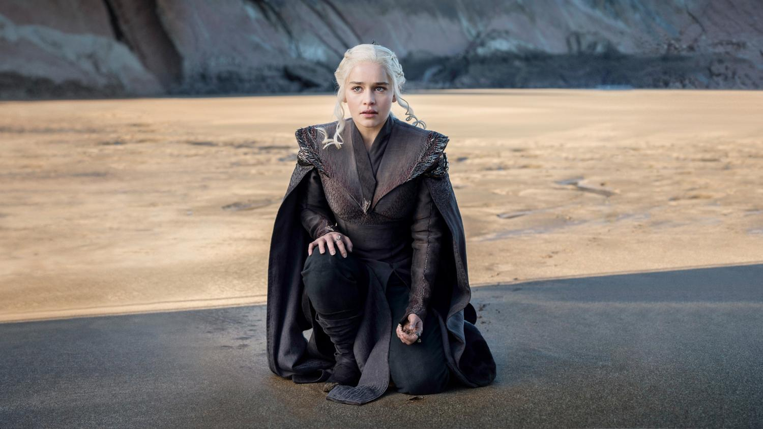 Daenerys Targaryen kneels at Dragonstone shore.