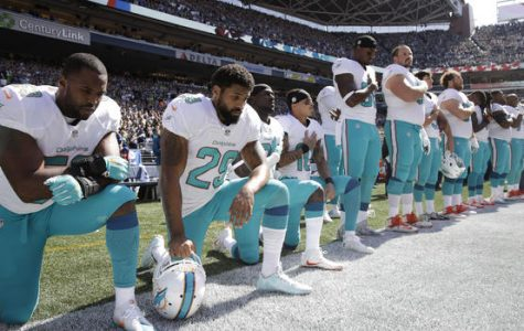 National Football League players take a knee