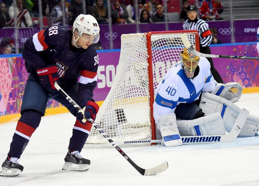 USA+forward+Patrick+Kane+%2888%29+takes+a+shot+against+Finland+goalie+Tuukka+Rask+%2840%29+during+the+first+period+of+the+men%27s+Bronze+Medal+hockey+game+at+the+Winter+Olympics+in+Sochi%2C+Russia.+Unfortunately%2C+the+Olympics+in+South+Korea+will+not+field+NHL+players.