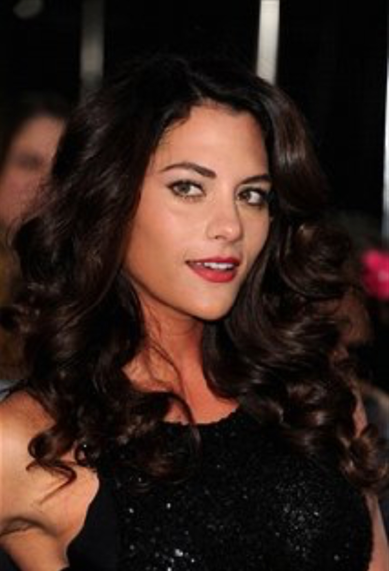Inbar Lavi, starring actress in Imposters, poses at the premiere of The Twilight Saga: Breaking Dawn Part 2