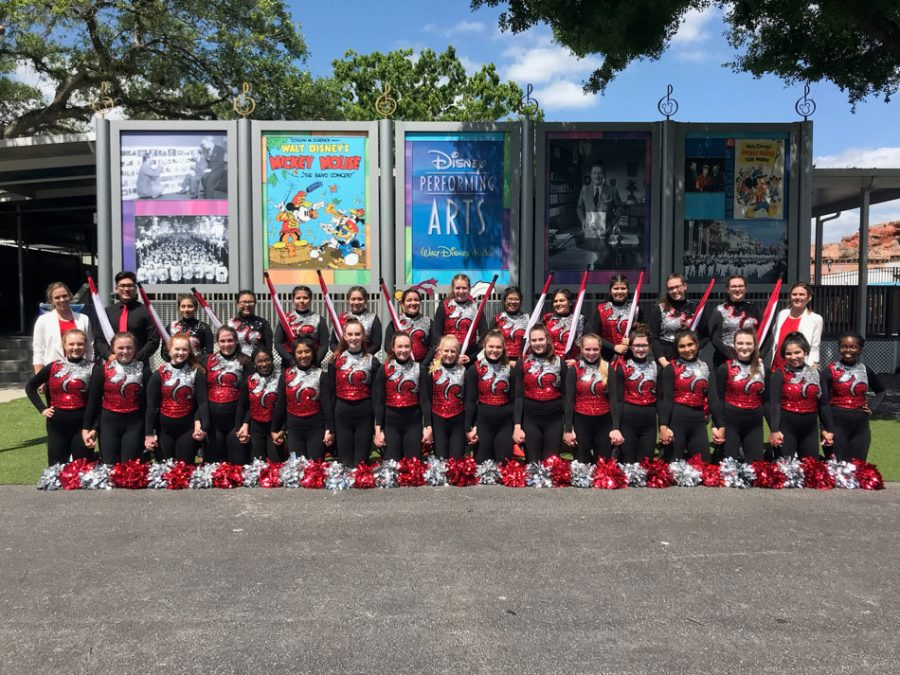 Poms and Color Guard in uniform before the parade through the Magic Kingdom on March 27, 2018.