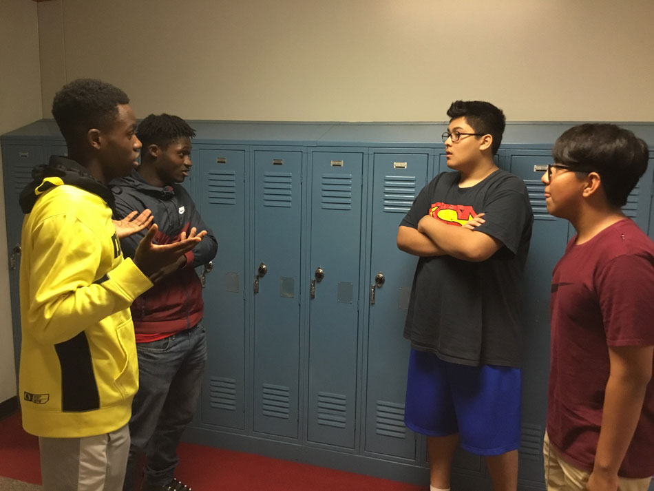 Seniors Demareon Collins and Marshawn Rayford give advice to Adam Ramos and Rafael Hernandez-Garcia .