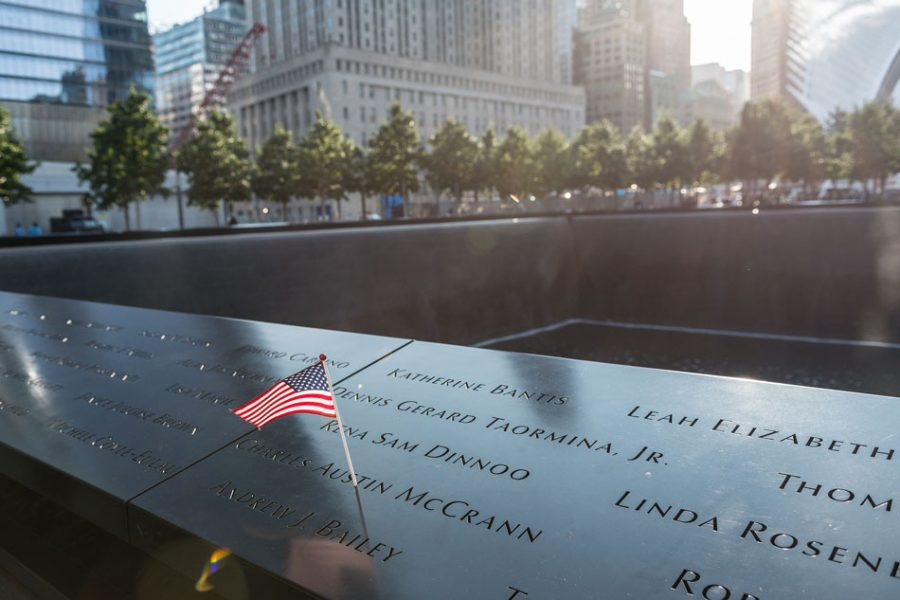 The name of a victim of the 9/11 attacks is seen adorned an American flag on the perimeter of a reflecting pool at a ceremony commemoratoing the 16th anniversary of the September 11th terrorist attacks at the World Trade Center site in New York, New York, NY, USA on September 11, 2017