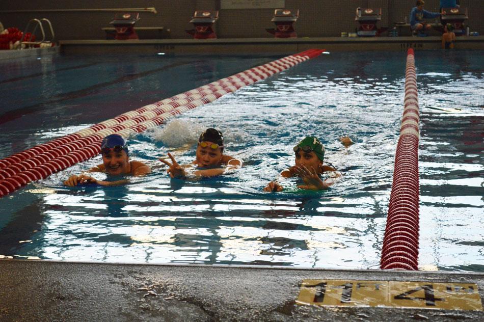 Megan Obernesser (19), Jane Smith (20) and Ola Gorecki (22) practice in preparation of the long swim season.