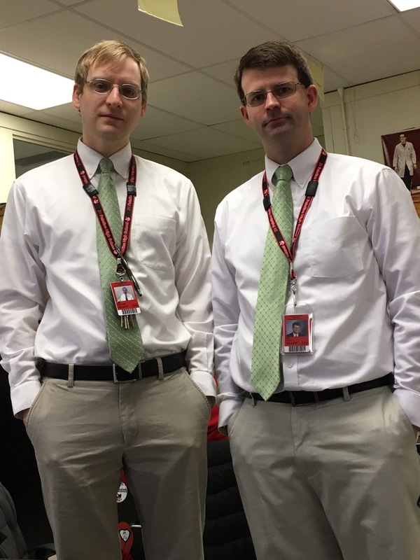 PHS science teachers Thomas Miller (left) and Ryan Hall pose in matching work attire.