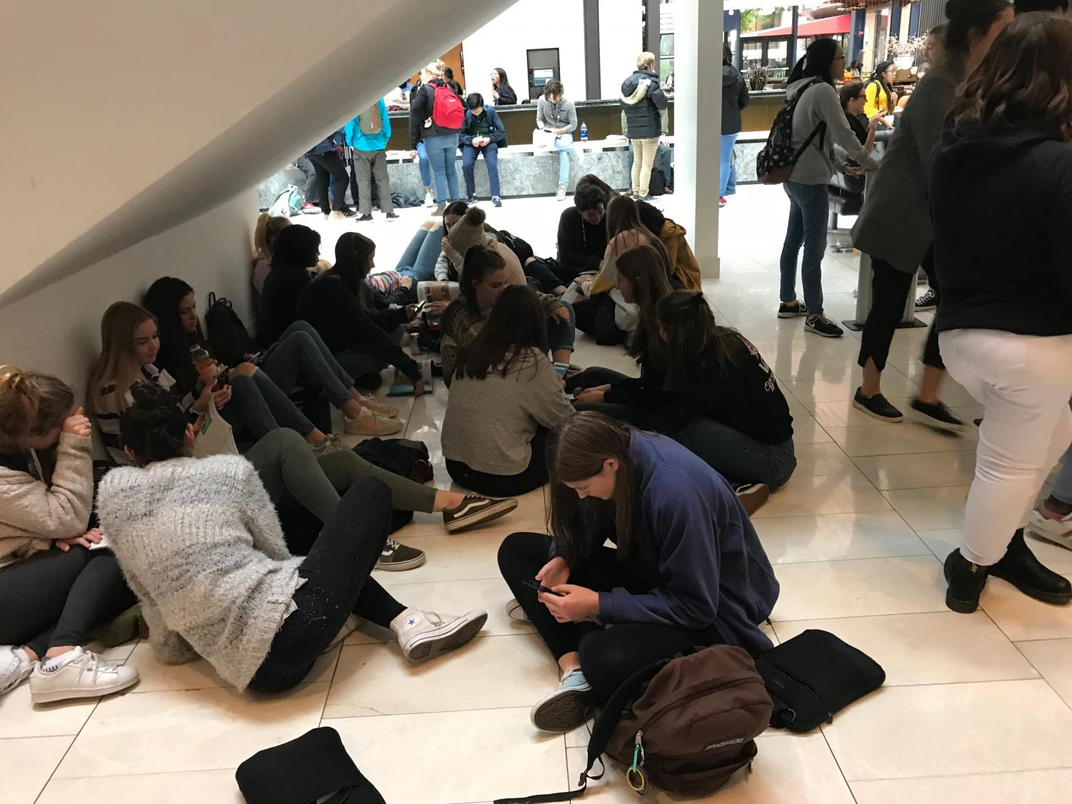 Students relaxing under the Hyatt Regency stairs at JEA/NSPA National High School Journalism Convention