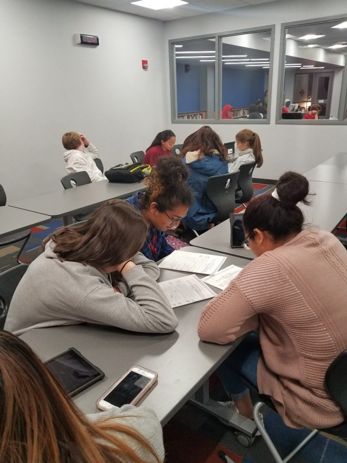 Spanish 2 and ESL students work together on a project.