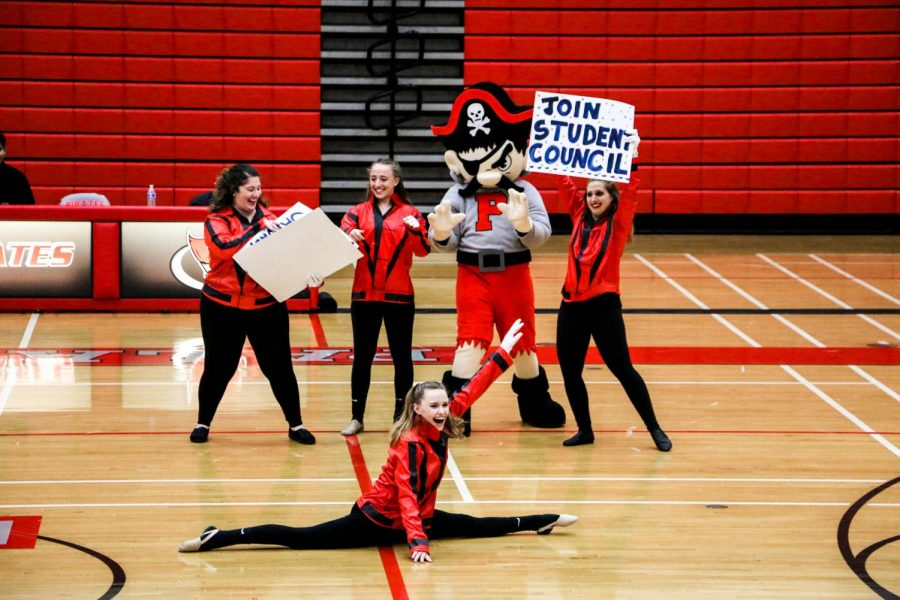 The+%22Jackson+5%22+end+their+performance+triumphantly+with+Pirate+Pete+as+their+secret+weapon.+The+crew+also+holds+signs+to+prompt+spectators+to+join+student+council+and+to+remind+students+to+buy+their+turnabout+tickets.+