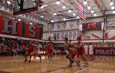 The Boys varsity basketball team compete against each other at the Red and White game.