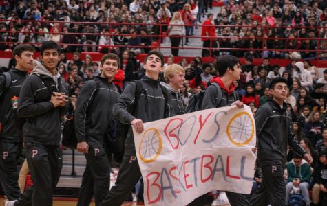 Varsity boys basketball wins against Fremd