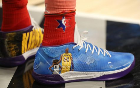Bam Adebayo of Team Giannis wears custom-decorated shoes depicting the likeness and name of Kobe Bryant and his daughter Gianna in the fourth quarter of the NBA All-Star Game.