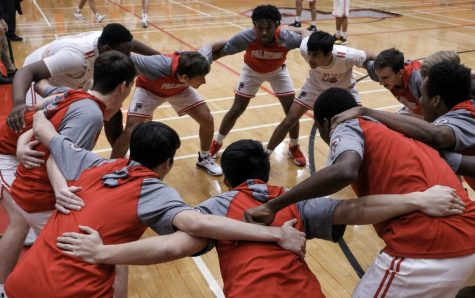 Palatine Boys Basketball prepares for a game with a huddle.