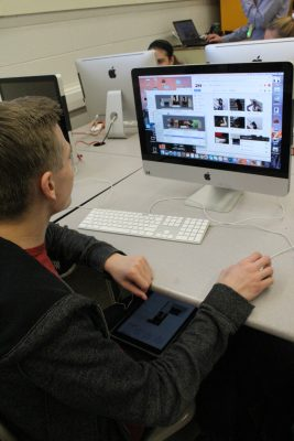 A PHS student using two screens to complete an assignment in 2017. With online learning, screen times have only increased.