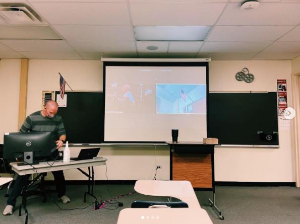 D211 plans to begin hybrid Dec 7 until winter break. English teacher Sean Berleman set up his work station for hybrid classroom.