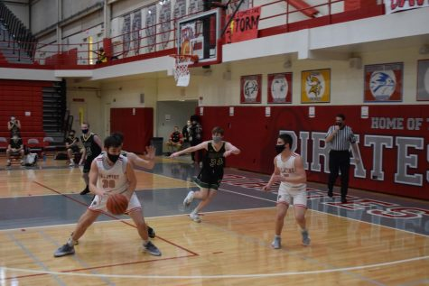 "Sam Millstone #5 and Tyler Sweirczek #30 are two of the youngest players on the Palatine High School varsity team. ""This season has been such a great opportunity to add a year of varsity basketball under my belt,"" Millstone said."
