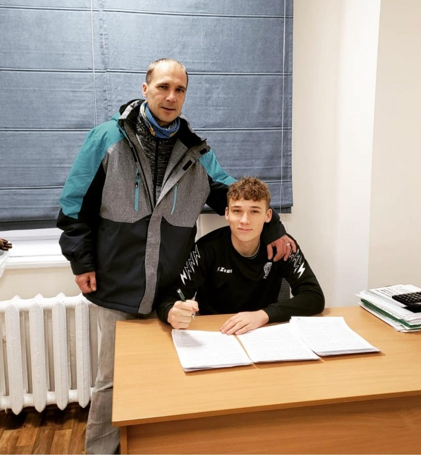 PHS Senior Tomas Dovidaitis, pictured with his father Marius Dovidaitis, signs his first professional soccer contract in Ukraine, announcing it on Instagram on February 8.