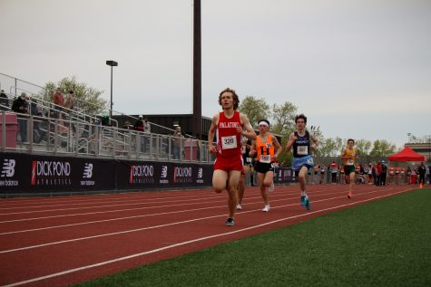 Andy Hansen runs in the boys 1600 meter with a time of 4:45.39