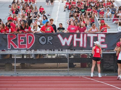 """PHS's Varsity club """"The Red Ryders"""" brings school spirit by hanging their """"Red or White"""" banner."""