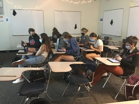 Creative Writing Club participating in a group writing session, about whatever they want